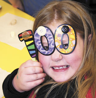 SES student Stevie Marie Turner shows her excitement for the 100th day of school by wearing glasses. Photo by Jamie Baker-Nantz