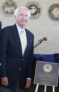 Gov. Steve Beshear stands by the plaque dedicating the Carillon tower as a living memorial to America&#039;s veterans.