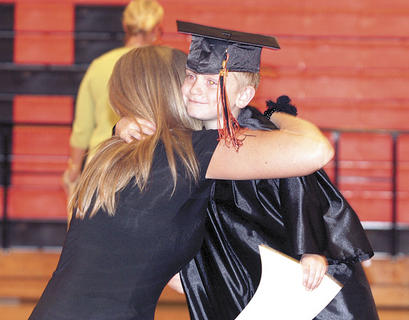 David Webster gives his teacher, Miss Heather, one final hug.