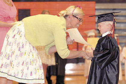 Hayden Osborne shakes the hand of his teacher, Miss Julie.