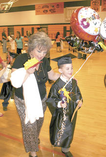 Spencer Stephens leaves graduation with balloons in hand.