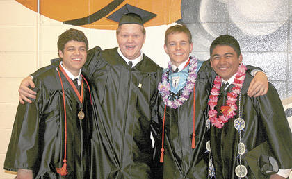 Aaron Disibio, Jacob Siedenberg, Matt Lillard and Simeon Skilling share one last photo at graduation.