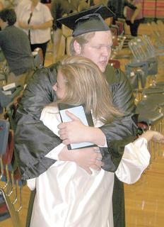 Jacob Siedenberg receives a hug from classmate Sammi Pendleton.