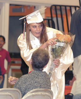 Kayla Pieper receives flowers before the ceremony.