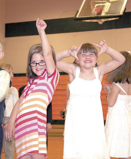 Emma Martin, left, and Karlee Robinson, right dance during a skit.
