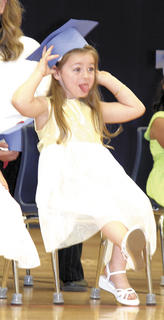 Macklyn McIntosh makes faces to family.