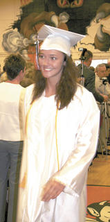 Taylor Jacobs smiles as she walks into the ceremony.
