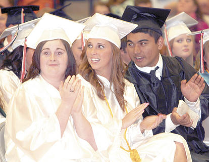 Tasha Webster, Makayla True and Simeon Skilling clap during the ceremony.