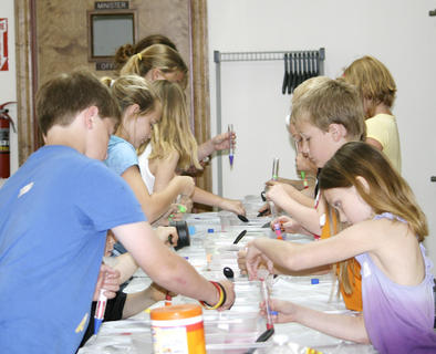 A group works on a sand art activity at Grant County Church of Christ Vacation Bible School.