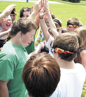 Danielle Smith gets SES students in a huddle before they begin a tug-of-war.
