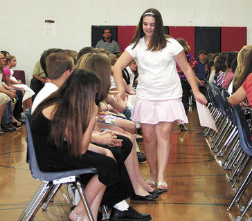 Summer Strong high five's her classmates during DRE's fifth grade graduation.
