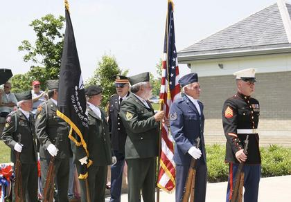Members of the Grant County Honor Guard prepare to post colors.
