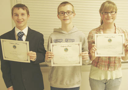 COUNTY WRITING WINNERS - Jordan Howard, first place; Nolan Calhoun, second place and Cassidy Lacey, third place.