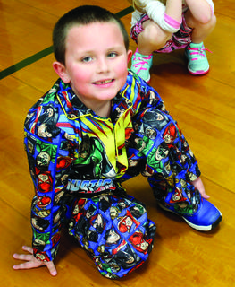 CMZ student Gavin Ratcliff waits for his turn in gym during Pajama Day on March 2.