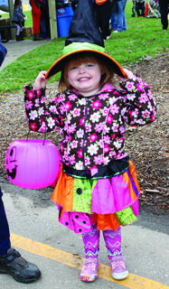 Three-year-old Haylee Edwards came as a little witch for Halloween festivities at Piddle Park. She couldn't wait for the candy line.