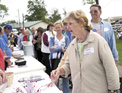 Sandra Bailey gathers goodies from local business during the Senior Bash.