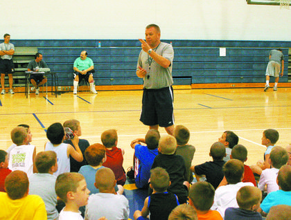 Grant County High School boys' basketball coach Jim Hicks teaches the kindergarten through fifth grade during camp on June 2.