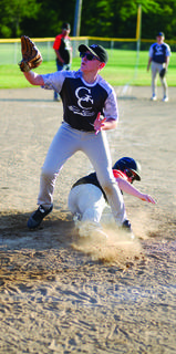 Johnathan Peer slides into the plate without getting tagged.