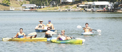 It was a sunny day to float along on Lake Williamstown Aug. 27 at the city's first Paddle Williamstown. Top, more than 150 turned out to canoe, kayak and paddle boat around the lake.