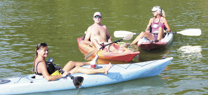 PADDLING ALONG - Joyce Hicks and Art and Debi Lyn Billington spent Saturday, Aug. 25 paddling around Lake Williamstown as part of the 2012 Paddle Lake Williamstown event.