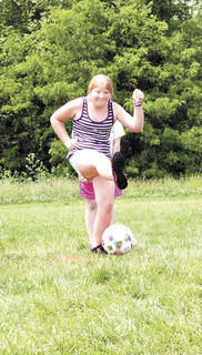 Lily Baker gets her leg behind it while playing kickball at SES track and field day.