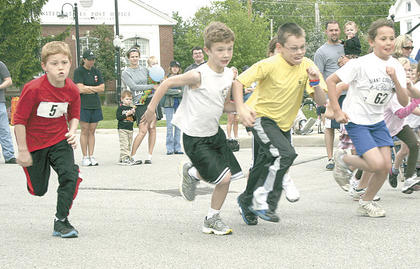 Runners get off to a fast start during the Kids Fun Run after the Derby Dash 5K as part of Williamstown's Derby Dash Festival on May 7.