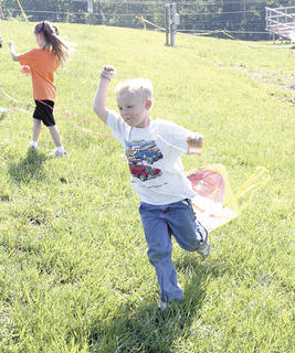 Josh Bodenhamer hopes for wind during a kite flying event at Williamstown Elementary&#039;s track and field day.