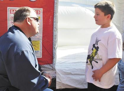 Williamstown Fire Chief Les Whalen discusses fire safety and fire prevention with Trinton Manning.