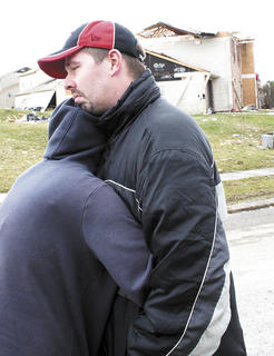Carla Wiltsie and her husband, Thomas, share an emotional moment after viewing the damage to their apartment.