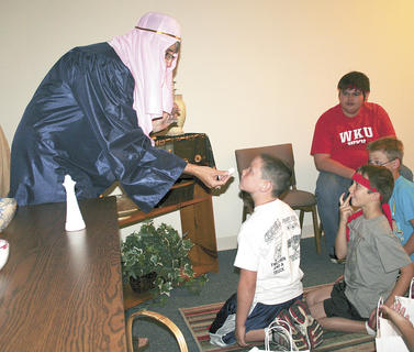 Tracy Goe teaches a bible lesson to Bryant Henson, Corey Rogers, Daniel Goderwis and Jake Kinman.