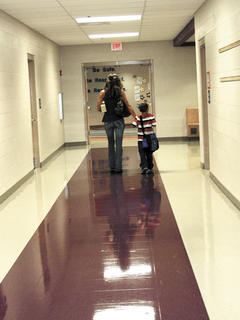 Aiden Peace, gets an escort to his first class at Sherman Elementary by his mother, Cornelia.