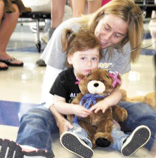 Kresta Stone and Lydia Smith take a break from the bear-building action at Dry Ridge Elementary.