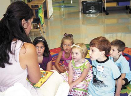 "Sherman - Lori Dawalt reads, ""Miss Bindergarten Gets Ready for Kindergarten"" to her future kindergarten students."