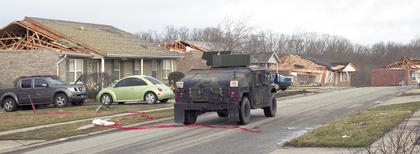 The Kentucky National Guard drive through the subdivision.