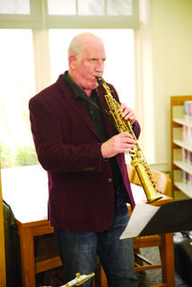 Rusty Bird entertains on the saxophone during the library's 50th celebration. Photos by Mark Verbeck