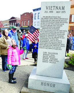 Clara Chiang views numerous veteran's names honored on a monument outside of the courthouse.
