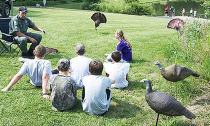 A group of participants gets a lesson on turkey behavior. 