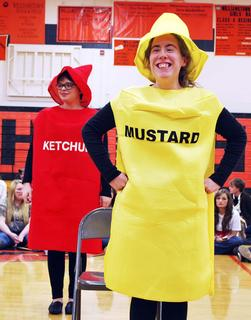 Ali Moore and Olivia Chandler dress up as ketchup and mustard for the senior auction.