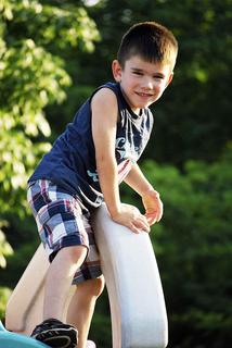 Daniel Souder is showing off his climbing skills as he climbs on top of the playhouse.