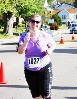 Amber Roundtree is elated as she crosses the finish line at the Derby Dash.