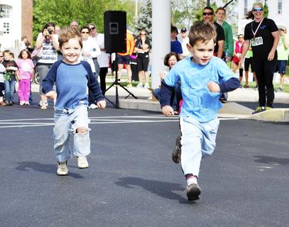 Rhett Shirrell run in the post-Derby Dash fun run during Derby Day on May 4.