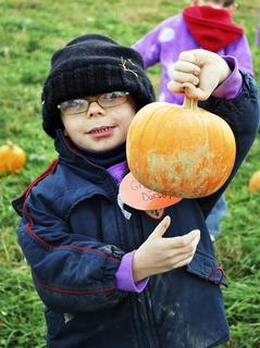SES student Gregory Dorsey shows off his pumpkin pick .