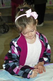 Cheyenne Barker colors a picture for the Easter Bunny at the egg hunt on April 7 at Grant County Park in Crittenden.