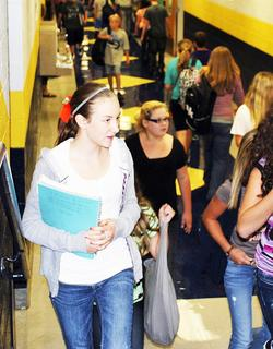 Grant County Middle School student Shelbyann Young walks down the hall 