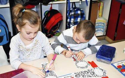 Crittenden-Mt. Zion kindergartners Avery Colson and Charlie Carroll draw as one of their stations in class. Stations included sets of 10 with 10 activity stations altogether. 