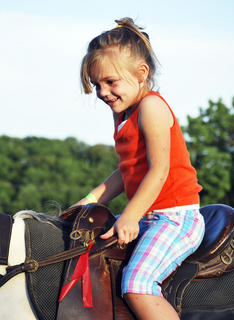 Ashlyn White are thrilled to be on horses as part of their Vacation Bible School. 