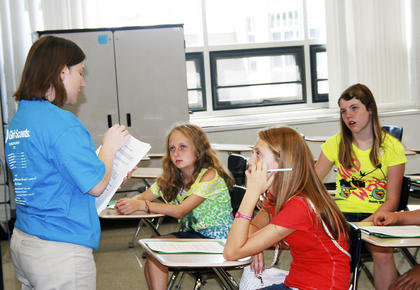 Wynita Worley, public services librarian, teaches Jaide Massey, Paige Simpson and Courtney Haggard about study skills during Camp Braves.