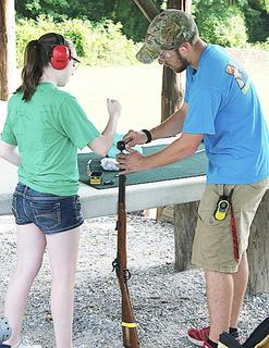 Laurissa Stidham of Hamilton, Ohio learns how to load and fire a muzzleloader. 
