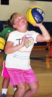 Emily Naranjo practices one of the skills, shooting one handed. 