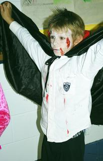 Kodie Cox dresses up as a scary vampire for the Halloween Parade at Mason-Corith Elementary.